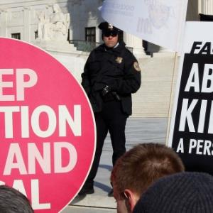 Are protests outside abortion clinics an expression of free speech or harassment of women?